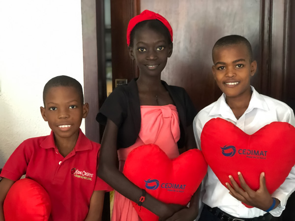 Naika and two other patients hold heart pillows after mitral valve repair surgery