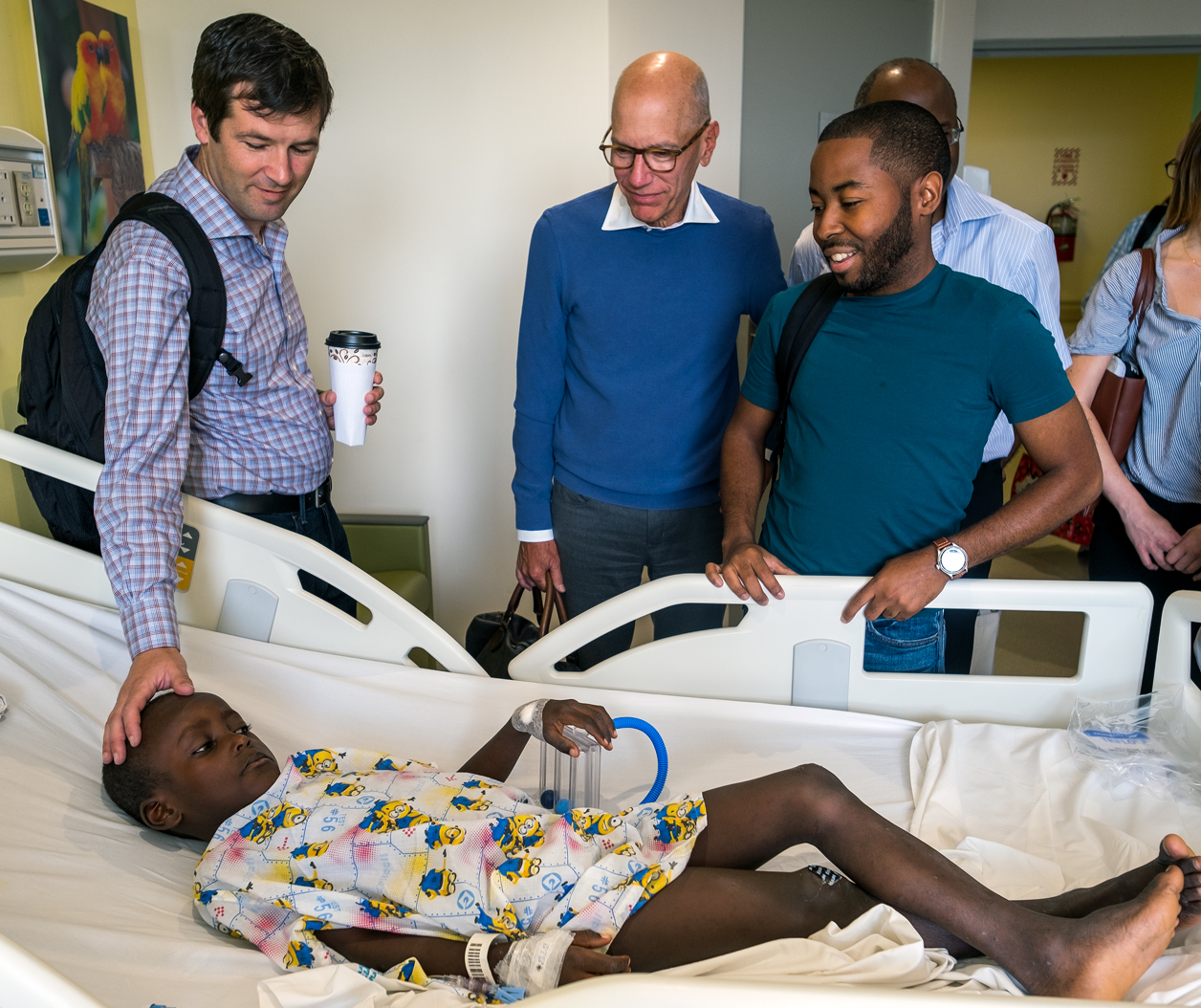 Before his surgery, Woodmylens meets Dr. Adams and team members from the Mitral Foundation and Haiti Cardiac Alliance.