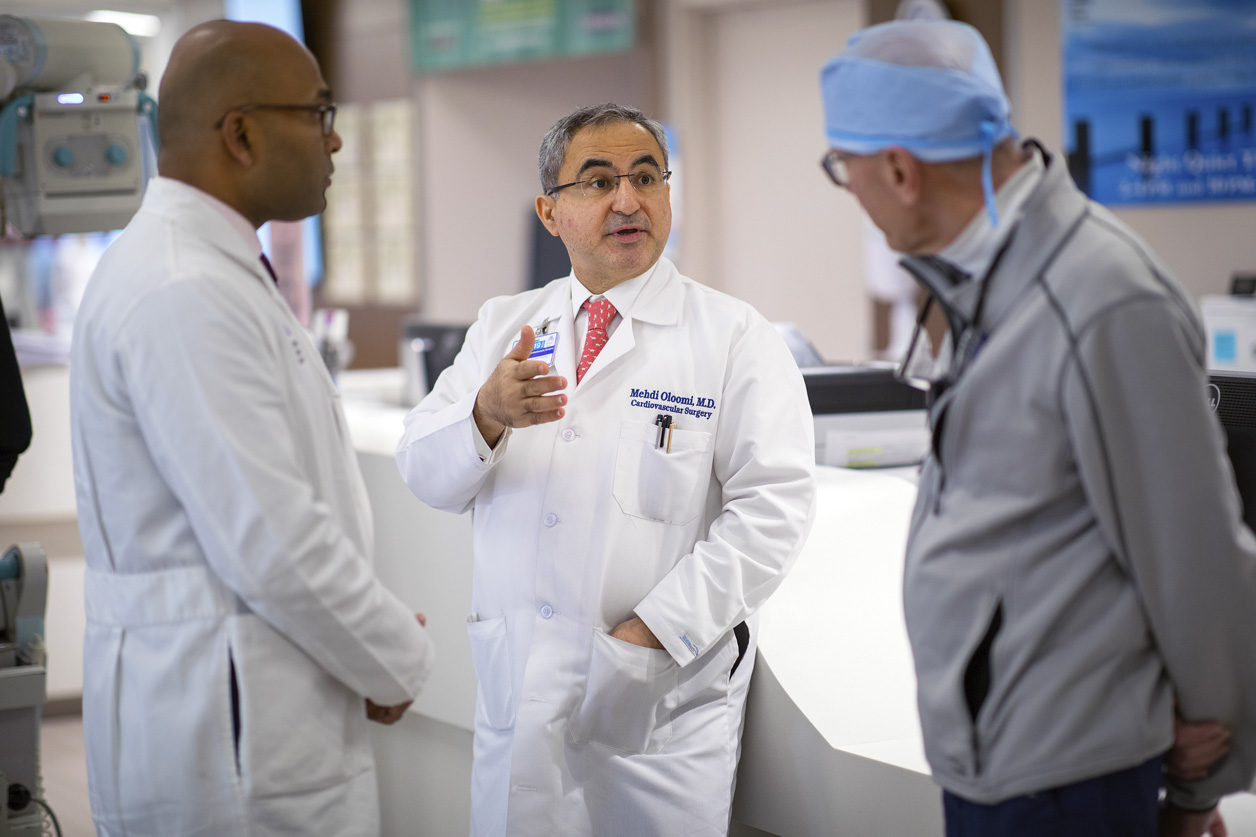 Dr. Oloomi consults with Drs. Adams and Varghese in the ICU at The Mount Sinai Hospital