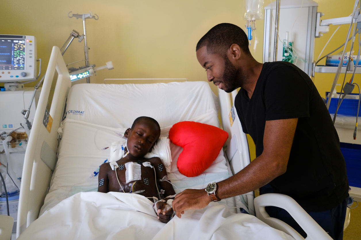 Mount Sinai perfusionist, Jean Defay, CCP who is originally from Haiti, visits with Woodmylens during his recovery